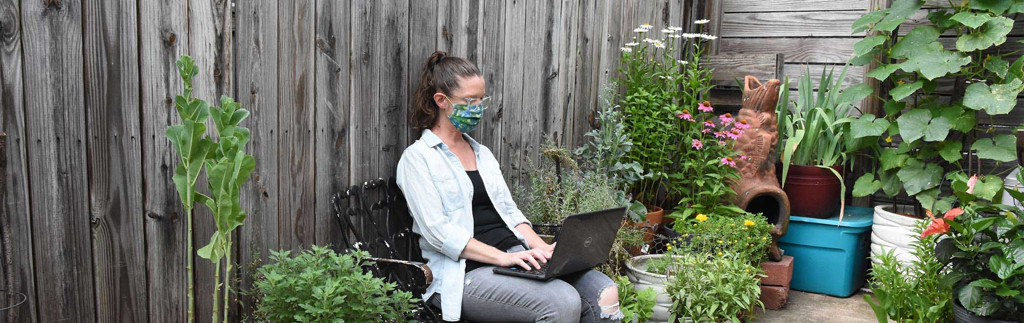 Lady in mask with a laptop